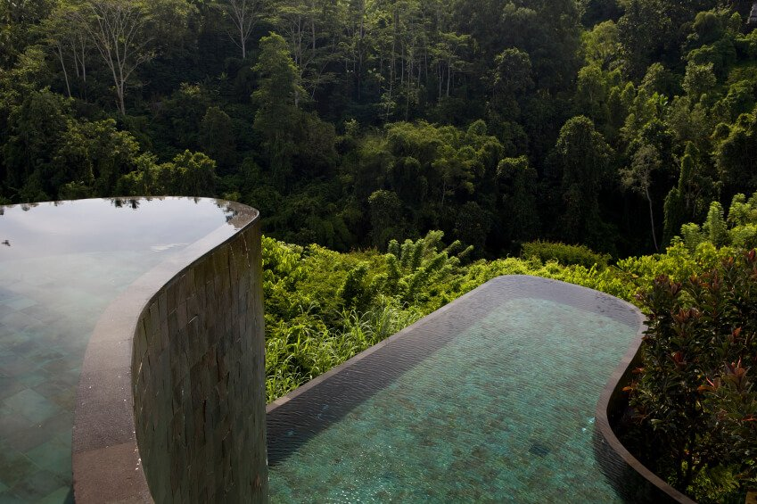 This gorgeous example is simply a work of art. The pool has two separate swimming areas. The edge of the top pool is flush with the wall leading down to the second, which allows the water to cascade over the edge and into the pool below.