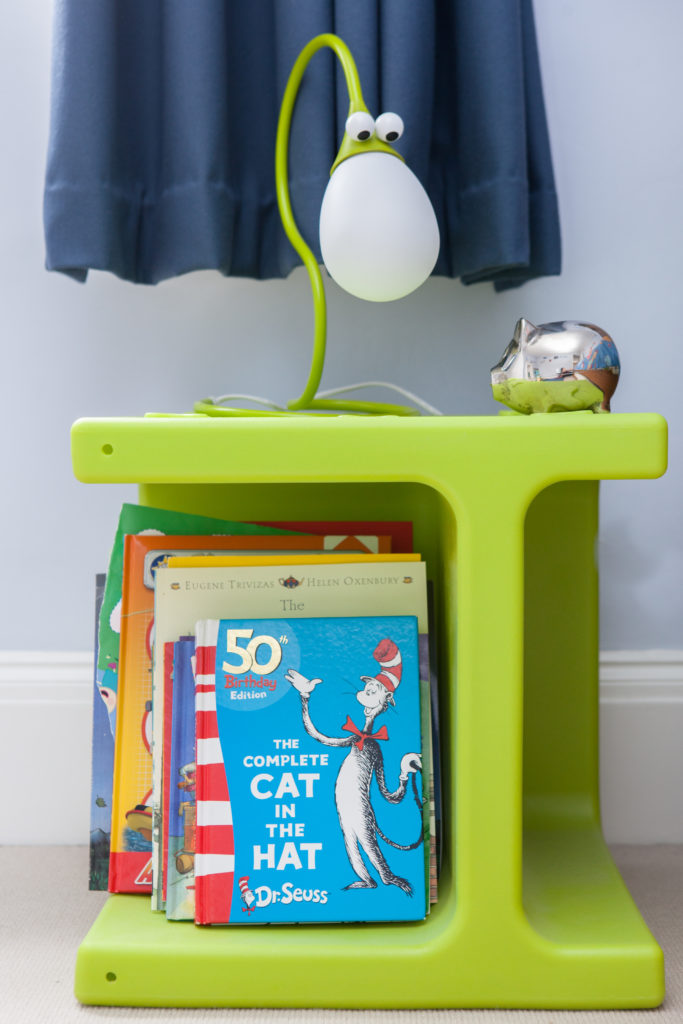 This small free standing bookshelf in lime green exemplifies the bright yet restrained details throughout the playroom.