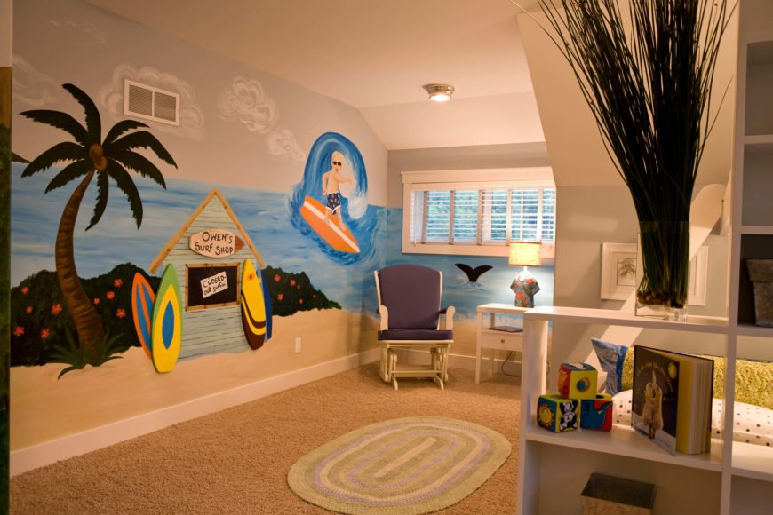 Next we move to one of the kids' bedrooms, with a surfing mural adorning the walls. Cubic shelving frames the bed, at right.