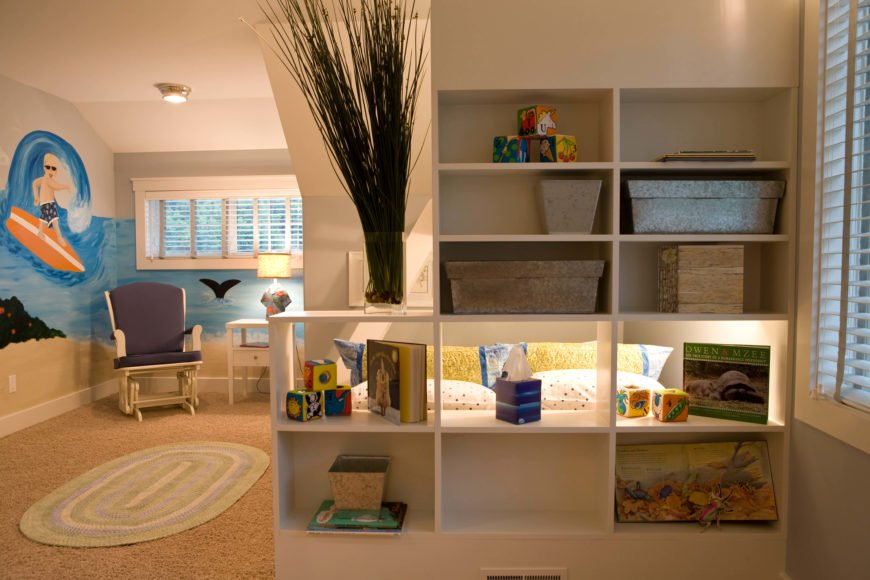 The bed-bracketing storage shelving features a pass-through shelf, opening the sleeping space to the rest of the room.