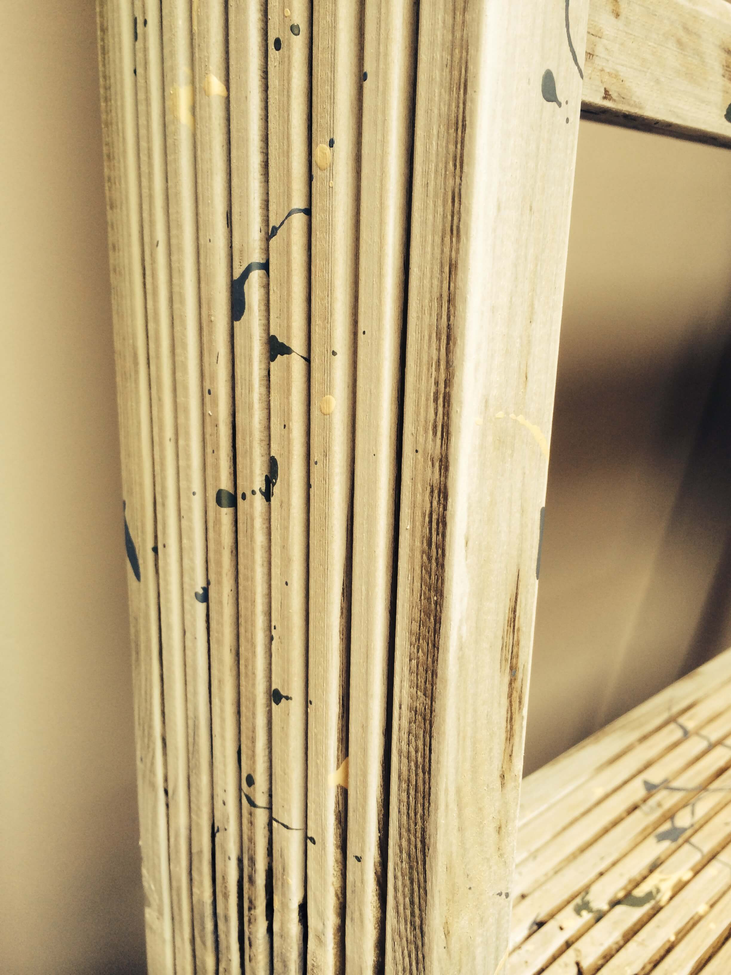 A close up of the side of the shelf, showing off the grain of the treated Scandinavian pine decking wood the shelving is made out of