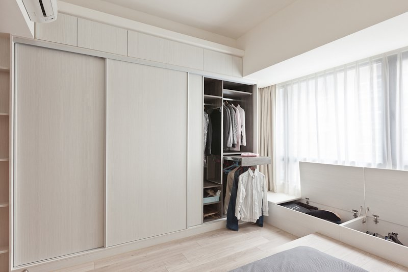 Space is utilized to maximum efficiency, with hidden storage below the windows, and a large closet with innovative slide-out racks and cubbies.