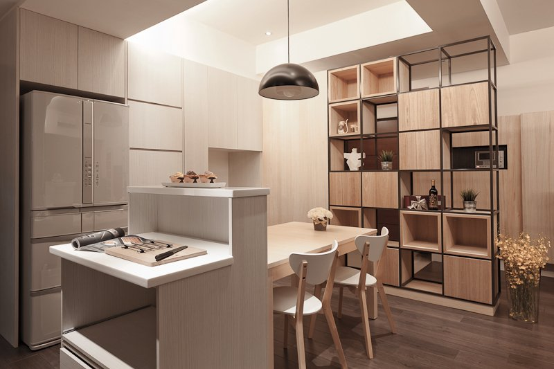 The kitchen island features a two-tiered design with ample storage space in a compact frame.