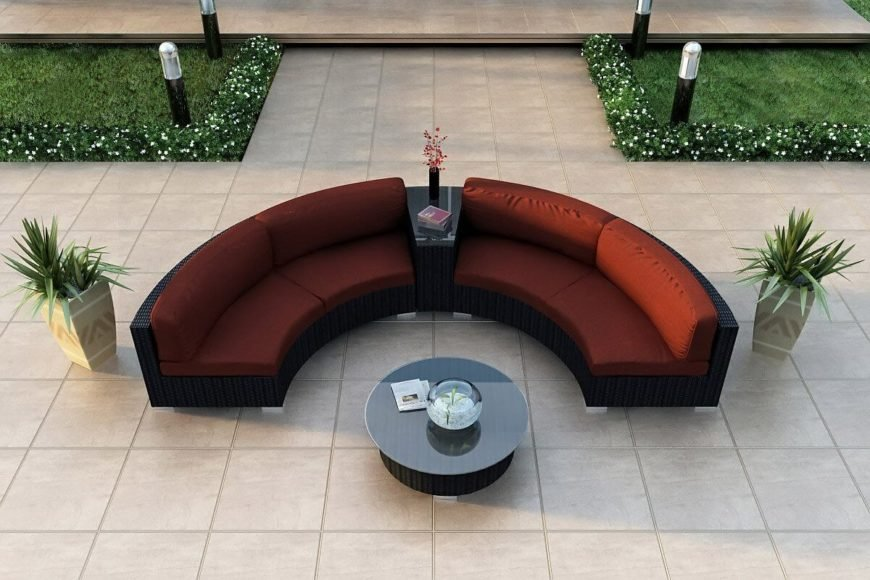 This boldly colored patio sectional features a unique design, segmenting the pair of seating sections with a table wedge. Glass top matches the large circular coffee table at center.