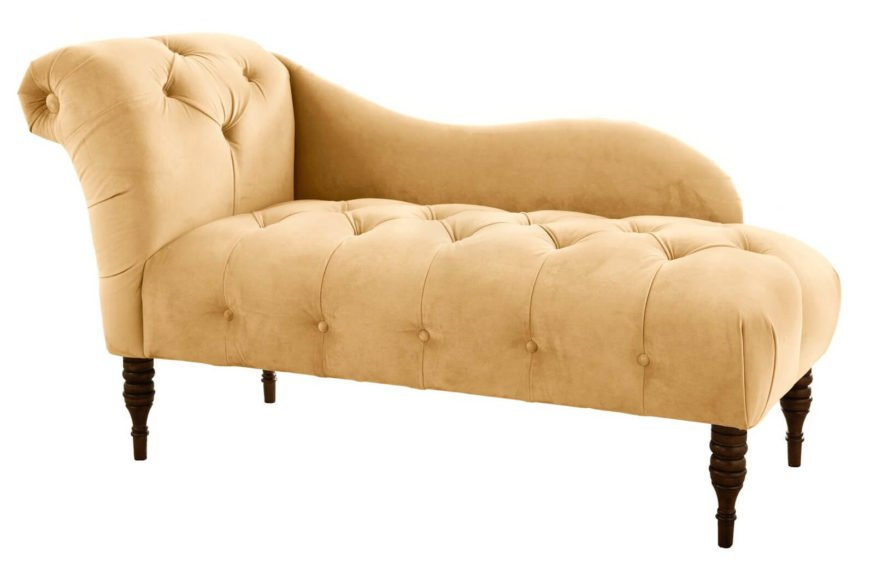 This classic design chaise lounge with half back and single roll arm features an extra thick button tufted surface over natural wood arrow feet.