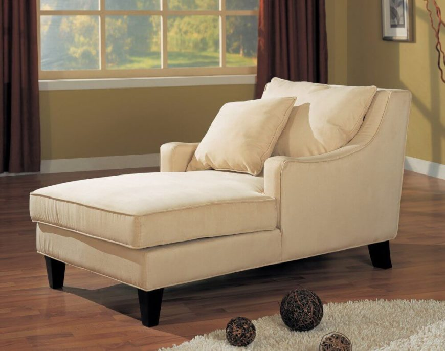 This light beige chaise features a full club-chair style backing with lengthy seat area for fully reclined seating.