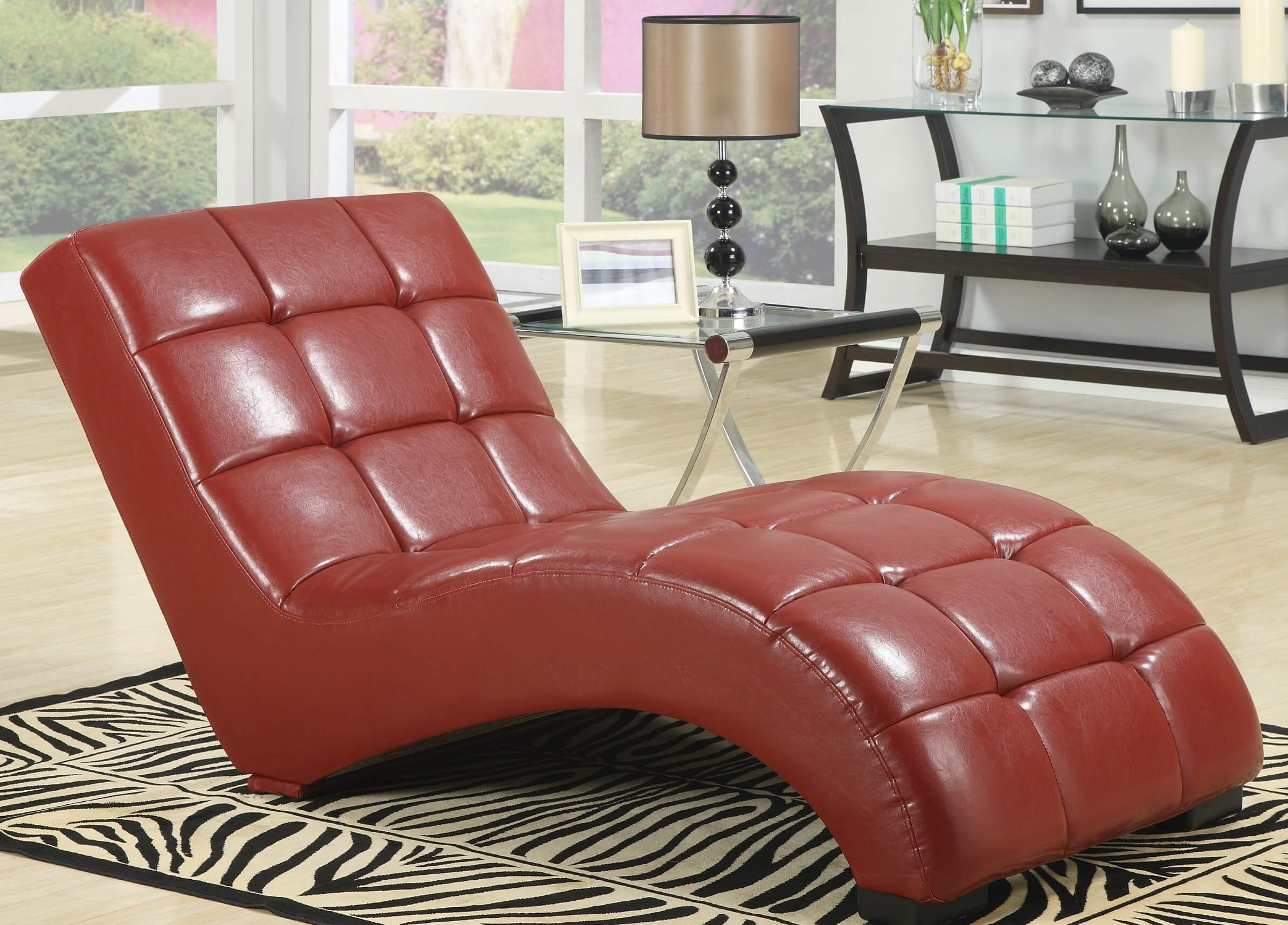 Similar to our top featured chair, this legless chaise fits rich leather over an arched frame. Button tufted thick cushioning ensures comfort, as does the low slung profile.
