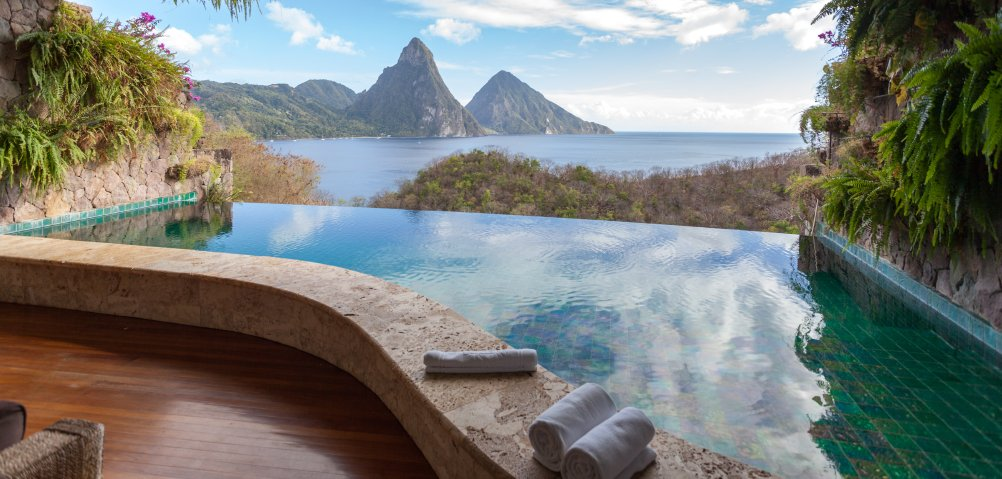 This infinity pool has a stone retaining wall that protects the rich wood patio from any accidental splashes. The zero edge of the pool looks over the mountainous side of the island and the bay.