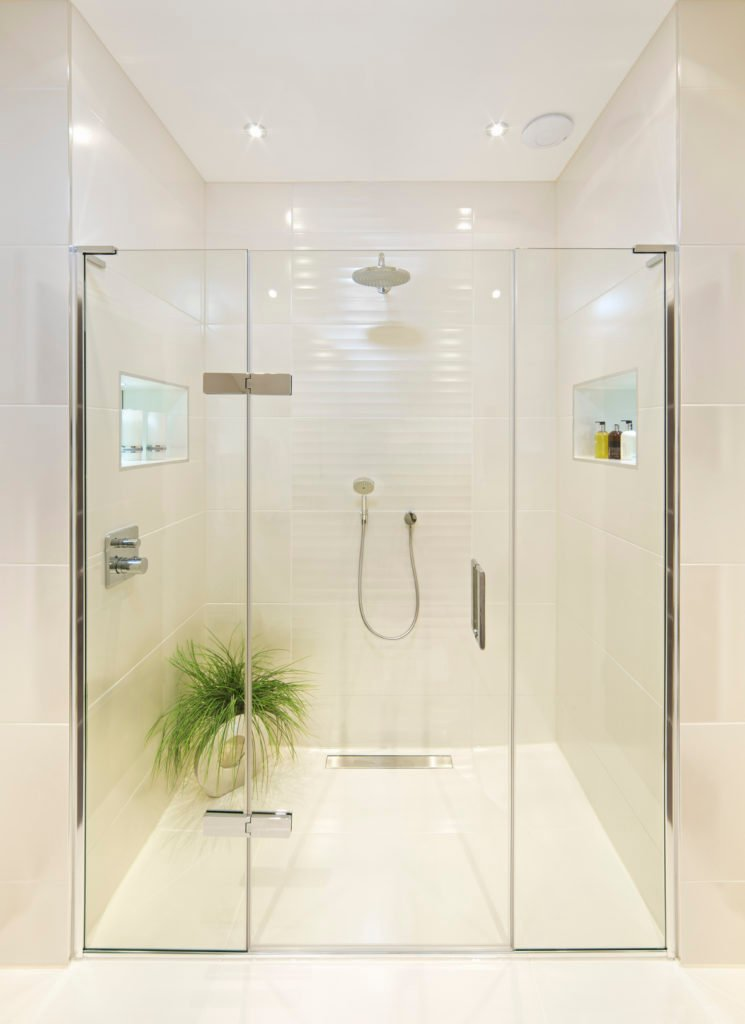 Stunning glass shower with rain shower head