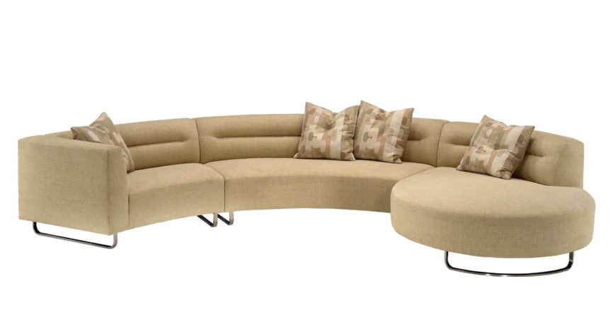 Here we have a sleek, contemporary curved sectional in cream colored fabric upholstery. Asymmetrical design and large rounded segment on the end make for a fascinating shape and a variety of seating options.