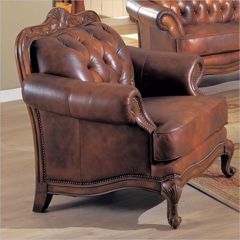 This button tufted leather club chair features a detailed wood frame and nail head trim framing a thickly cushioned seat and back. Claw-foot legs complete the elegant look.