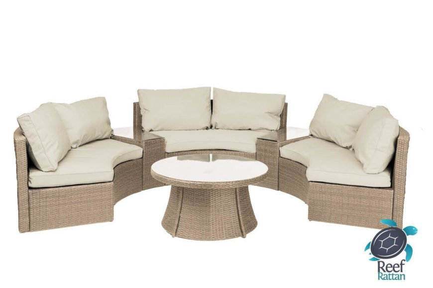 Here we have another patio sectional with a sturdy rattan body. Connective table segments divide the seating, with glass tabletops matching the large circular coffee table at center.