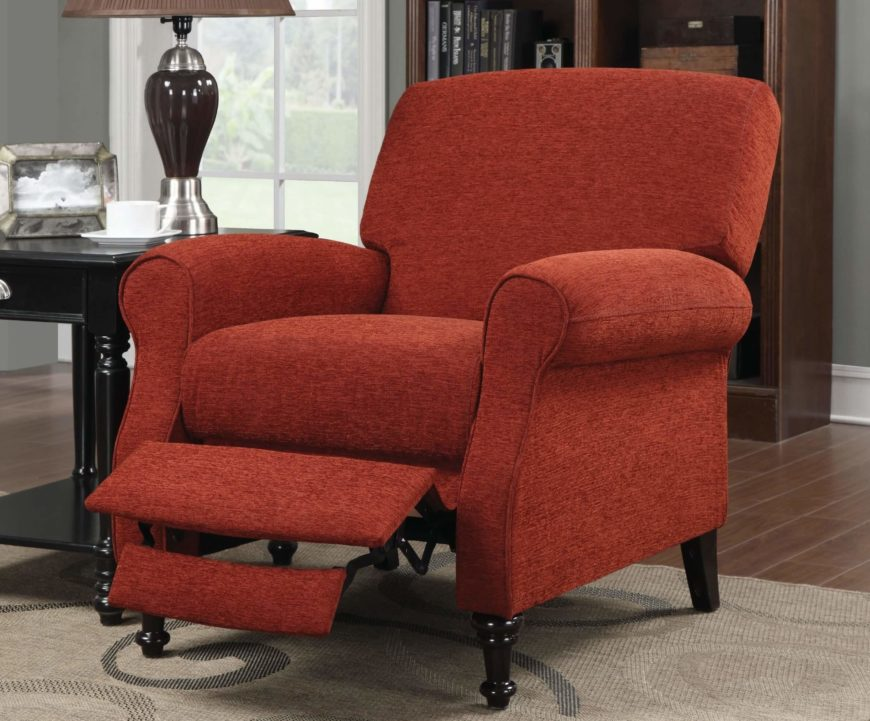 This red fabric upholstered recliner features a push back action, requiring no lever to move into fully reclined position. Dark wood arrow feet add delicate contrast.