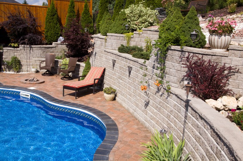 Terraces of multiple heights surround this pool complex, creating a private oasis.