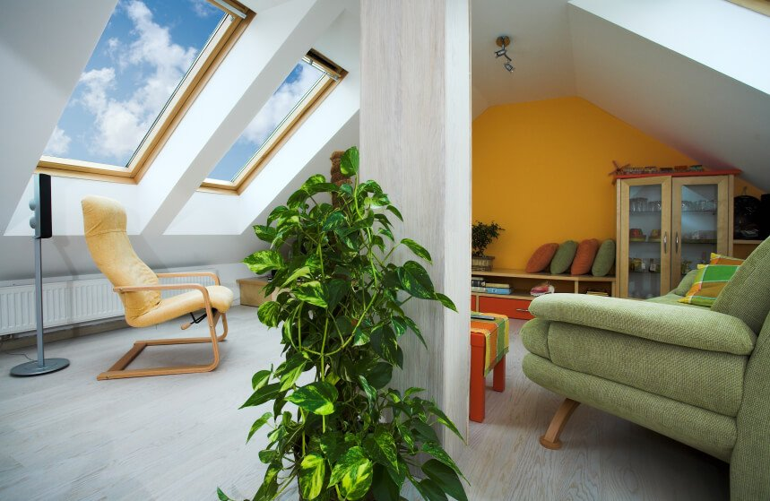 An attic living room with skylights.