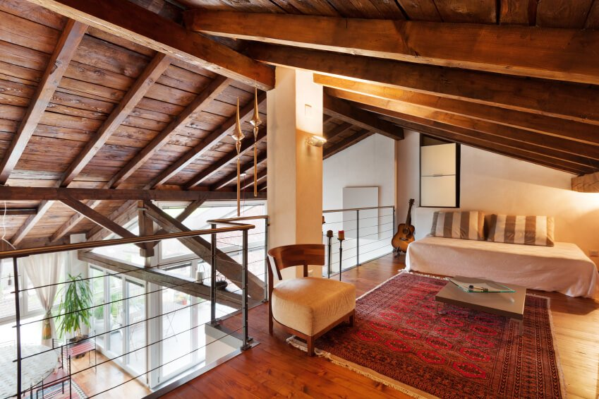 This loft has high glass balustrades and looks down over the dining room. The style is a mixture of contemporary and traditional.