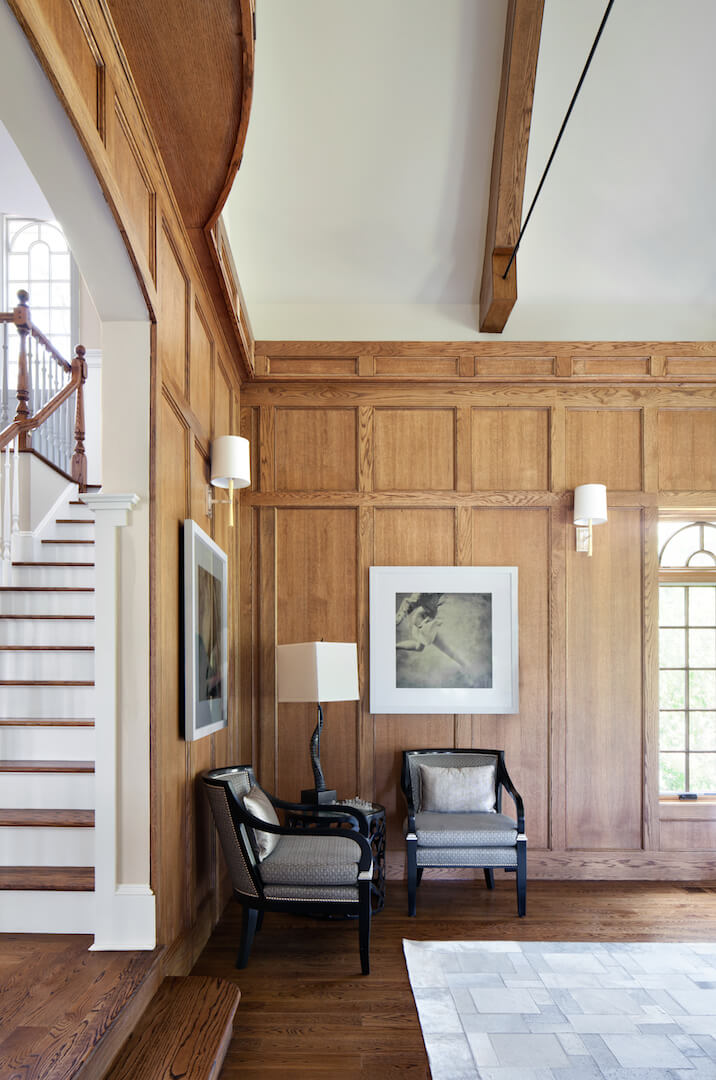 On the left when you enter the room is another small seating area with two chairs. Visible to the left of the frame is the staircase in the foyer.