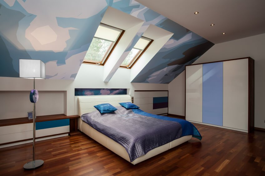 A computer-generated image of a bedroom features graphic wall art, color-blocking, and a cream leather platform bed.