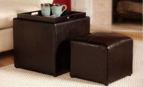 This unique cubic leather ottoman features a nested doll structure, concealing a smaller ottoman within its storage compartment. The lid can be reversed and act as a small coffee table or dining tray.