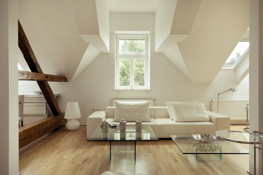 Another image of the above attic, showing the natural wood railings that visually separate each side of the attic.