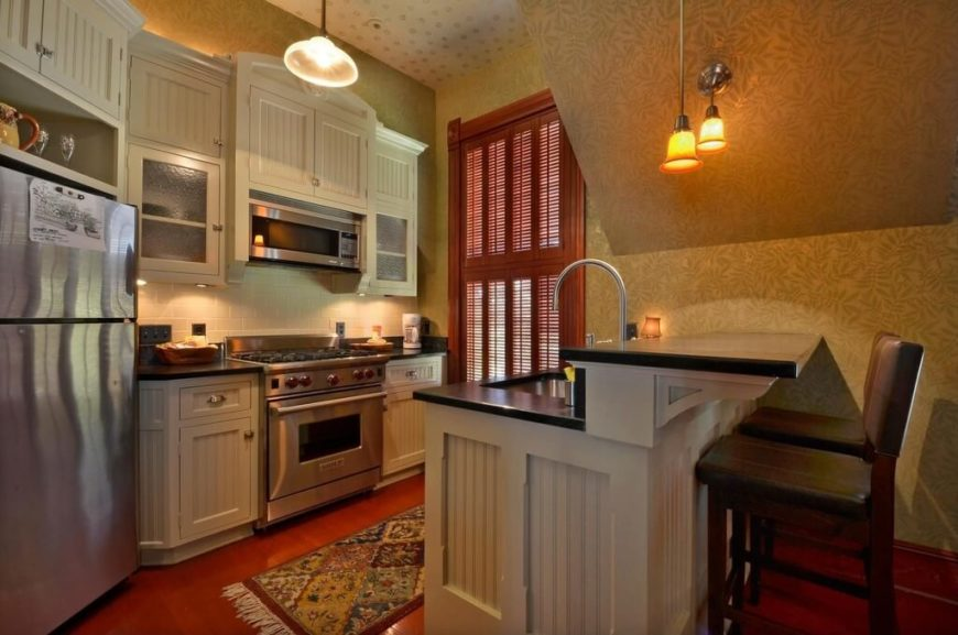 A small kitchen with a <a class=