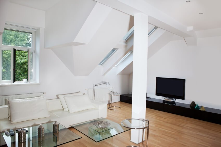 A view of the right side of the room, with skylights and an entertainment center in black.