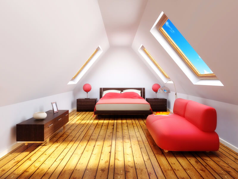 This computer-generated image features distressed hardwood floors, ample sunlight, and a spacious layout with bold color and modular furniture.