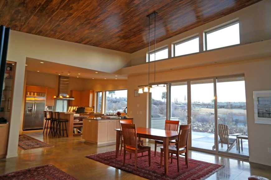 The glass doors lead out to the rear of the home, where there is a small patio and acres of open space.