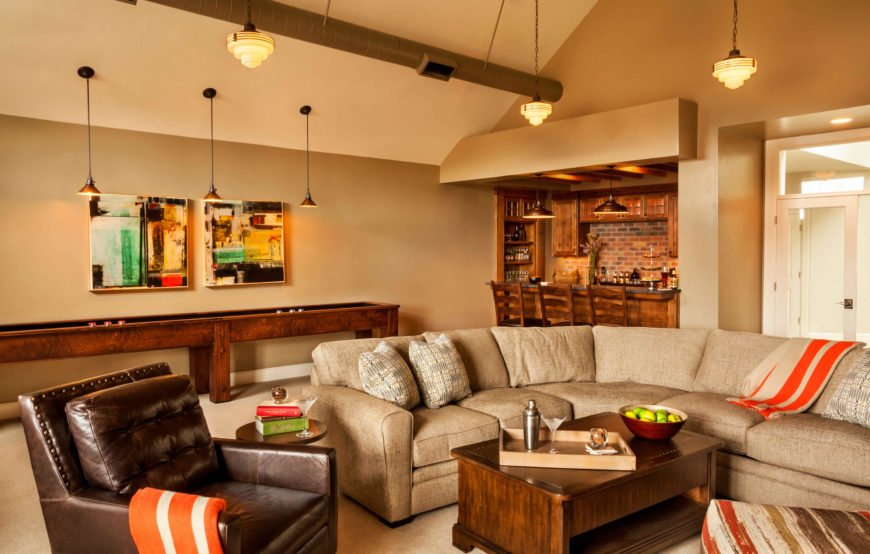 A view of the rec room showing both the seating arrangement and the bar. The spacious room has plenty of room for a Superbowl party.