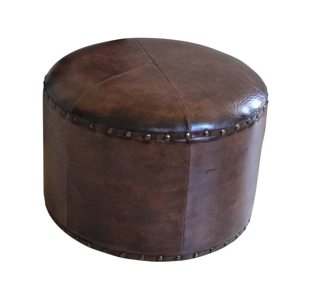 This cylinder ottoman in chocolate brown features upper and lower nailhead trim on the body, with matching cushion top.