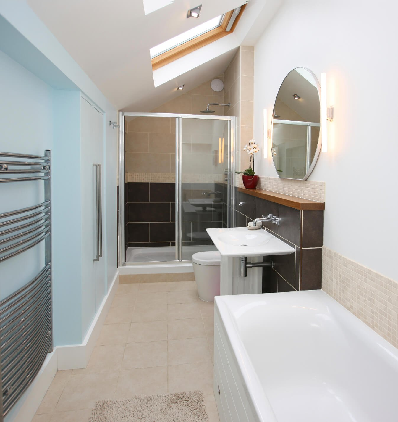 The above skylight hovers high above this simple bathroom, allowing sunlight to drench the space.