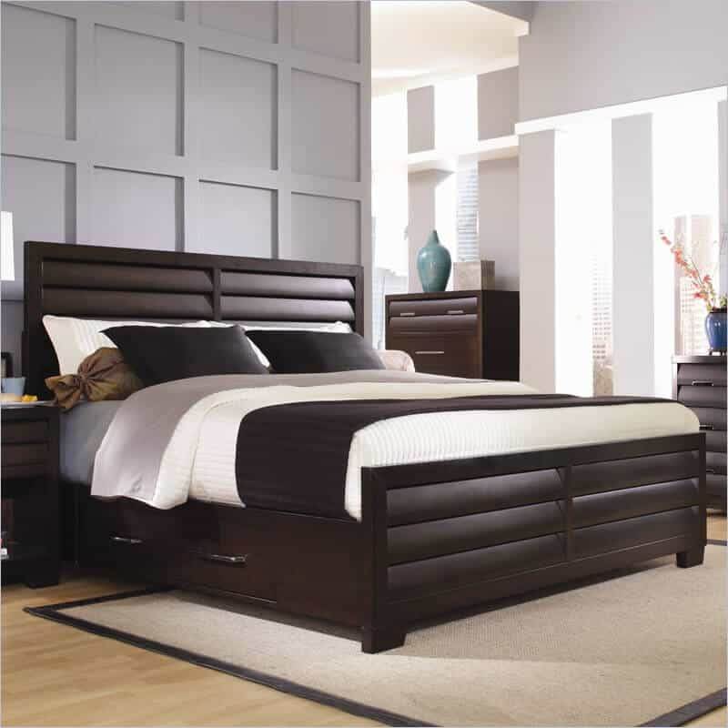 A unique style bed with smokey nickel hardware and concave and louvered drawer fronts. The base holds four storage drawers.