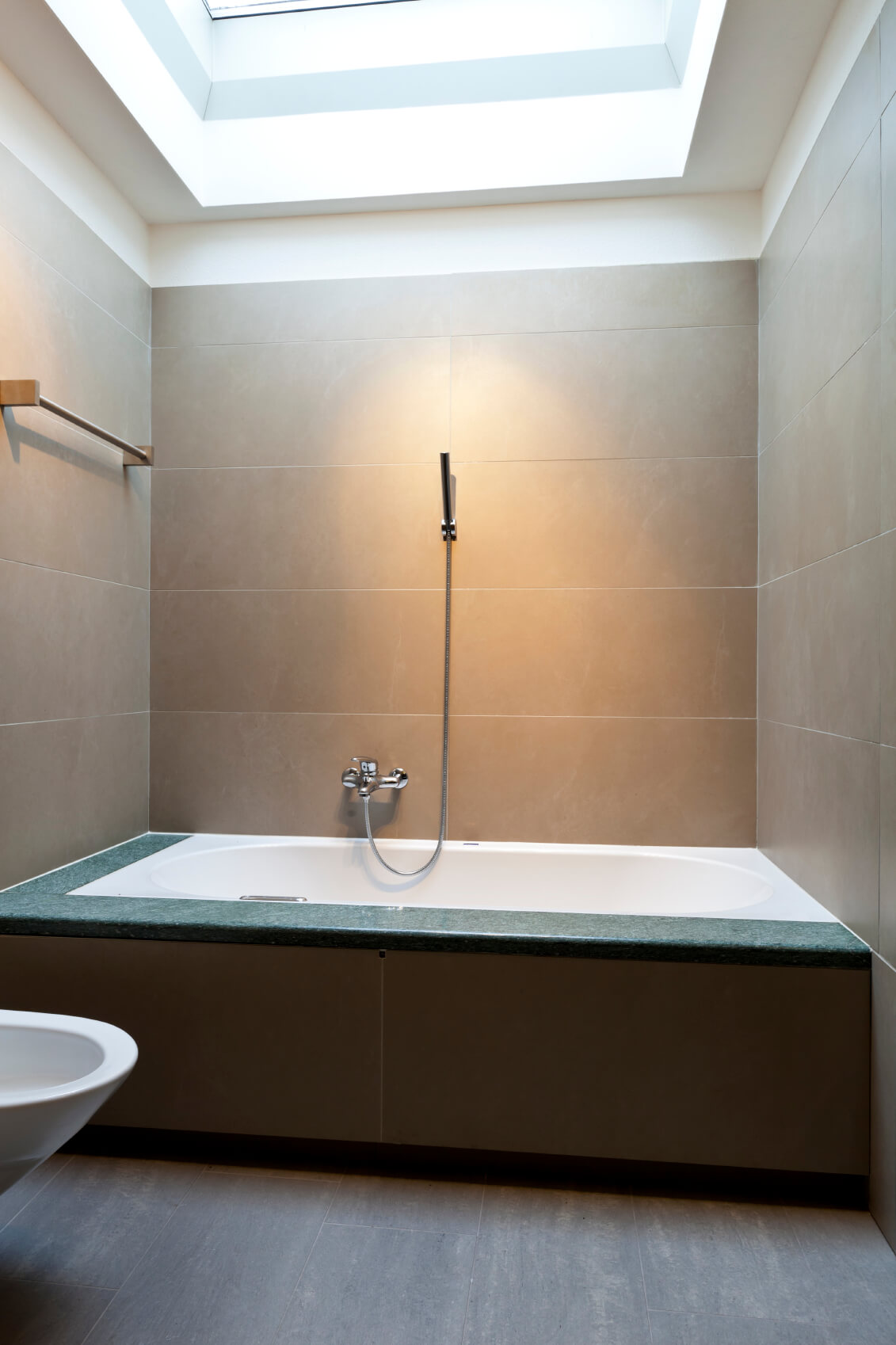 Another view of the previous bathroom highlights the stunning effects of the skylight.