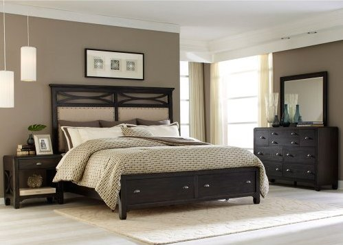 """A solid rubber wood with a dark finish. The curved """"x"""" design accents of the headboard complement the panels below. Antique pewter nail head trim runs along the perimeter of the panels. The bed has two storage drawers in the footboard"""