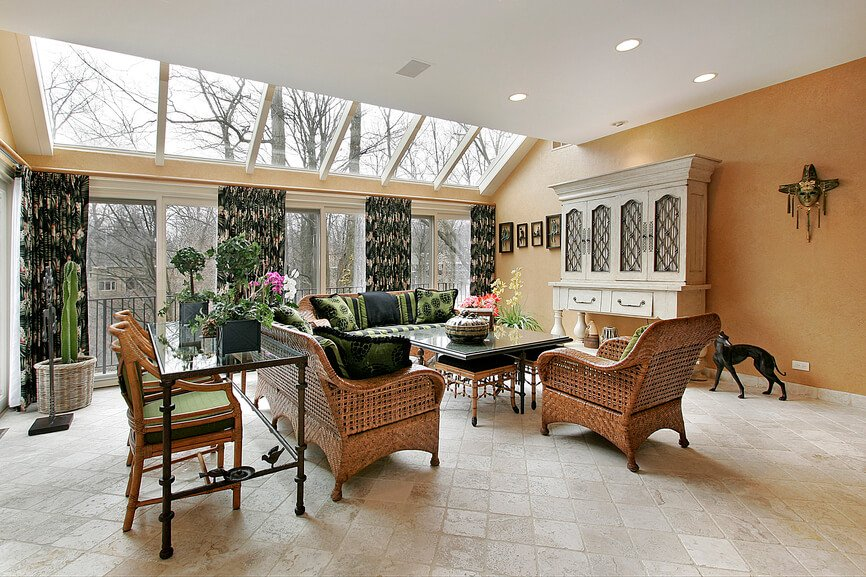 This great living room gives the great feeling of a patio, while still being inside. The geometrical skylights angled towards the wicker seating sets a tranquil atmosphere, even in cloudy weather.