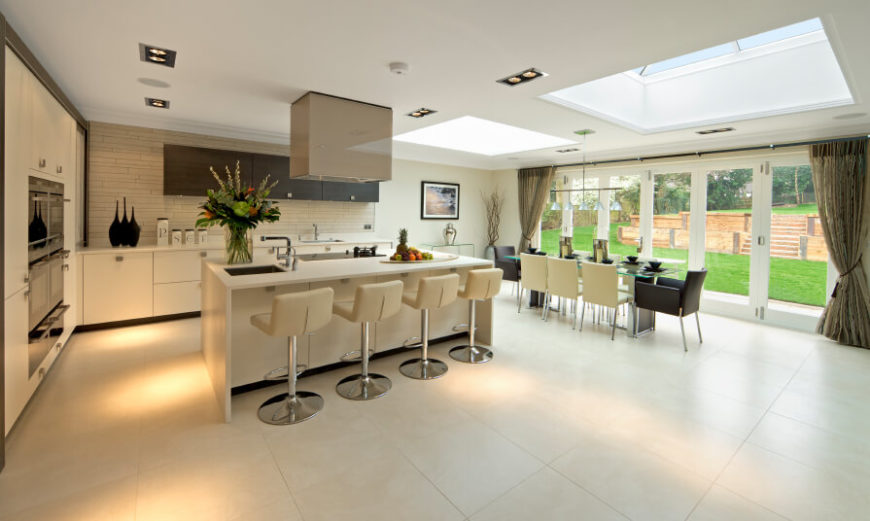 This kitchen is very classy and designed with style in mind. Two large skylights enhance the dining area for a blissful change in lighting.