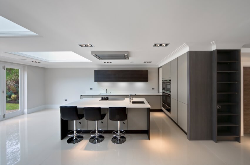 Modern colors, and a contemporary polished look bring this kitchen together. A skylight creates an asymmetrical look to the ceiling.