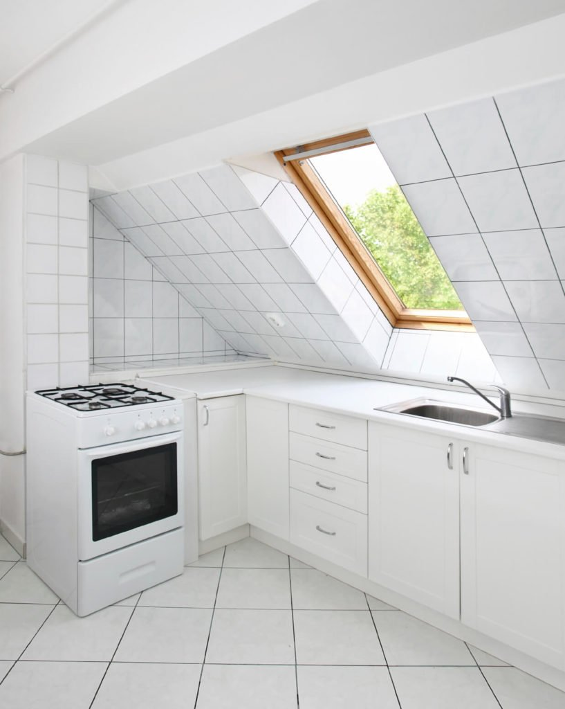 This skylight allows more light than the average one, because of the kitchens placement near the roof. It's angled to give sunlight to more than just the kitchen.