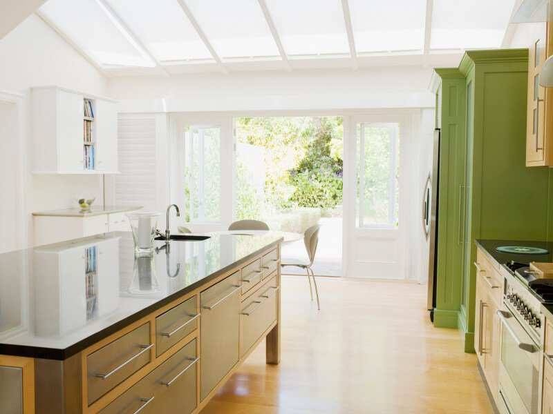 This cottage kitchen has beautiful and natural hues and tones. The ceiling is lined with skylights for a simply breathtaking glow.