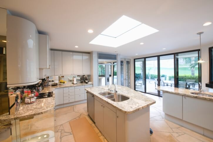 This kitchen has a beautiful rounded movement to it, that pulls the eye in towards the middle of the room. The center of this space is light by a large skylight to enhance the flow of the room.