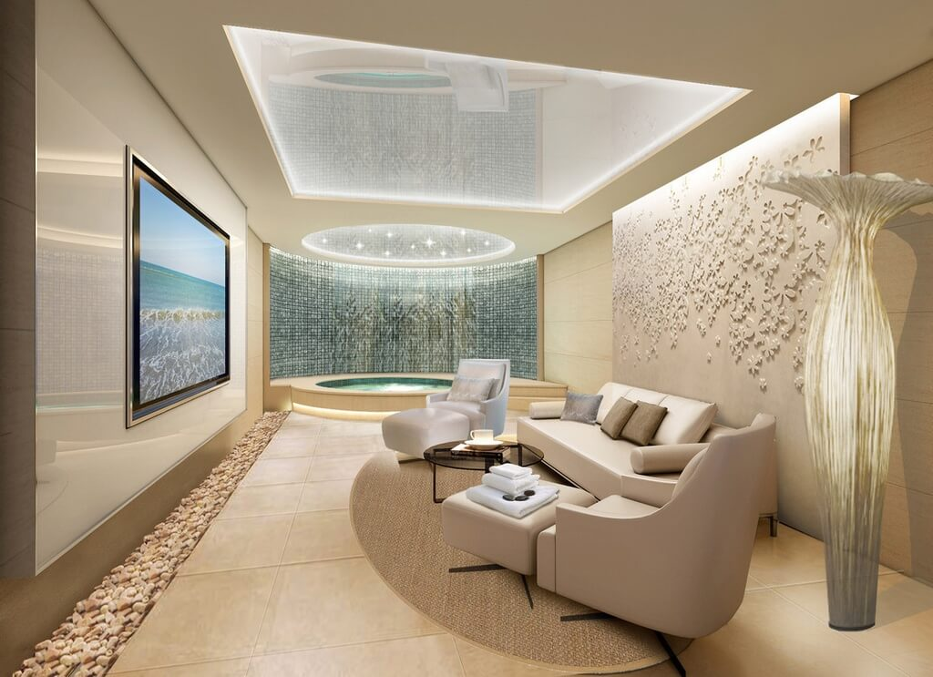 This upscale spa room features lavish details from a pebble lining on the floor, to intricate designs on the wall. A splendid skylight lighting the entire room with a warm and sober radiance.