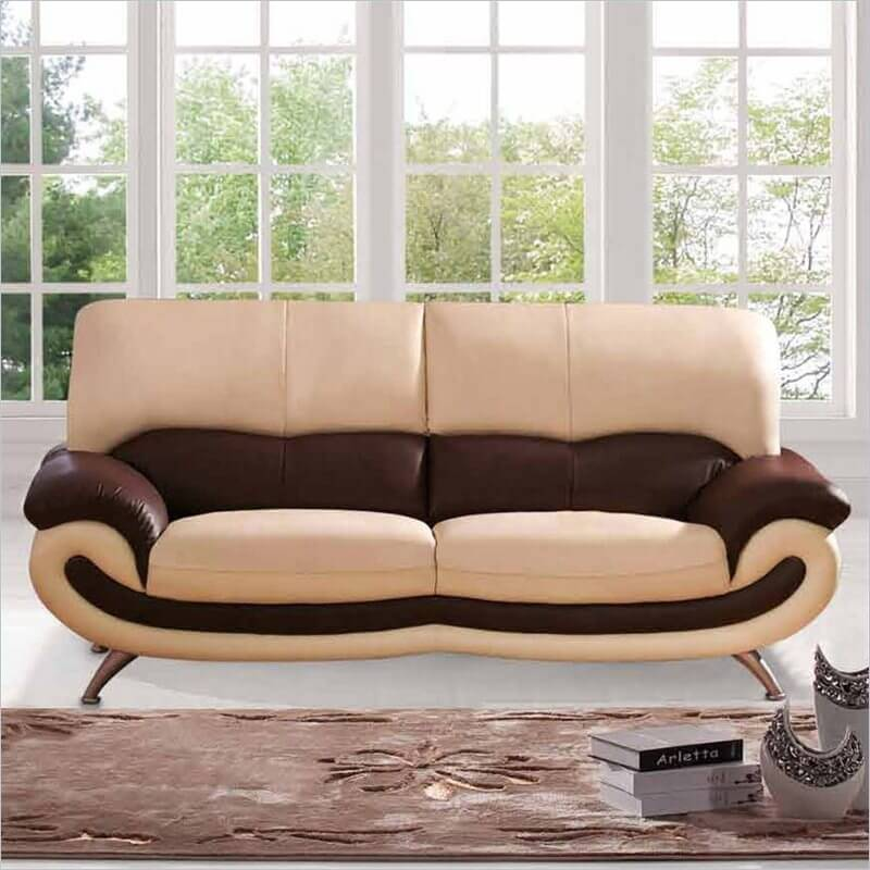 Here's a truly modern design sofa, mixing beige and brown layers of leather with a unique frame that curves up into the armrests below a plush back.