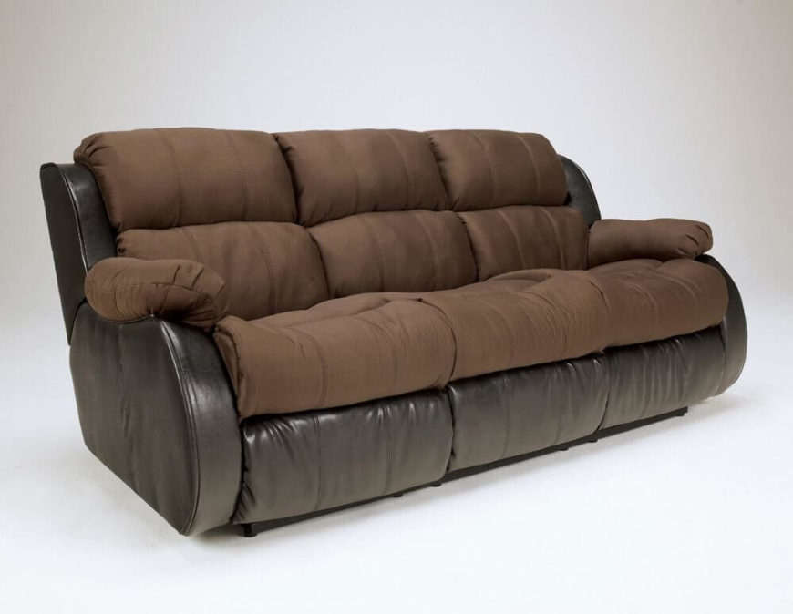 Our next sofa mixes leather and fabric upholstery, with all contact surfaces in soft mocha brown fabric over a leather frame. The rounded shape and thick cushioning make for excellent comfort.