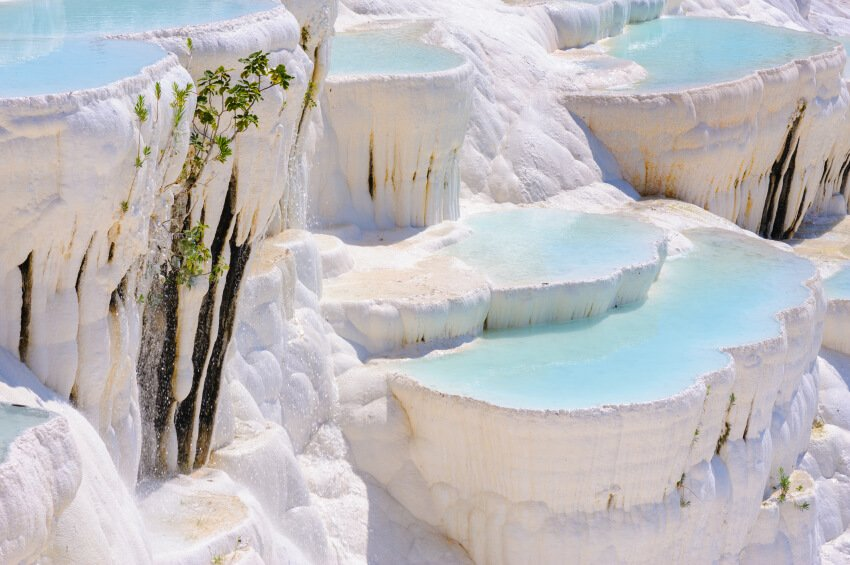 Travertine pools are a form of limestone deposited by mineral springs and hot springs. They tend to have a concentric, stepped appearance.