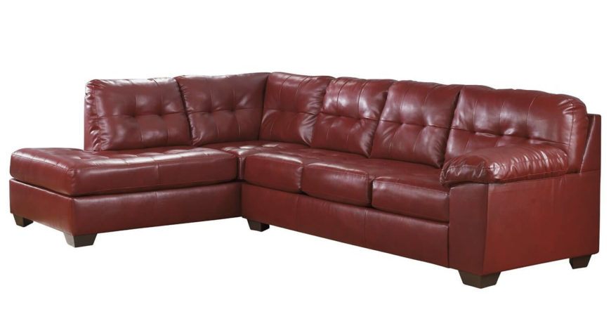 This super comfortable sofa features a sectional design, incorporating a chaise lounge. Rich red leather wraps button tufted cushioning over a contemporary frame.