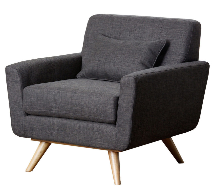 This club chair features modern low-profile design, with textured grey cloth upholstery over wide seat and back cushions. Angular natural wood legs add contrast.