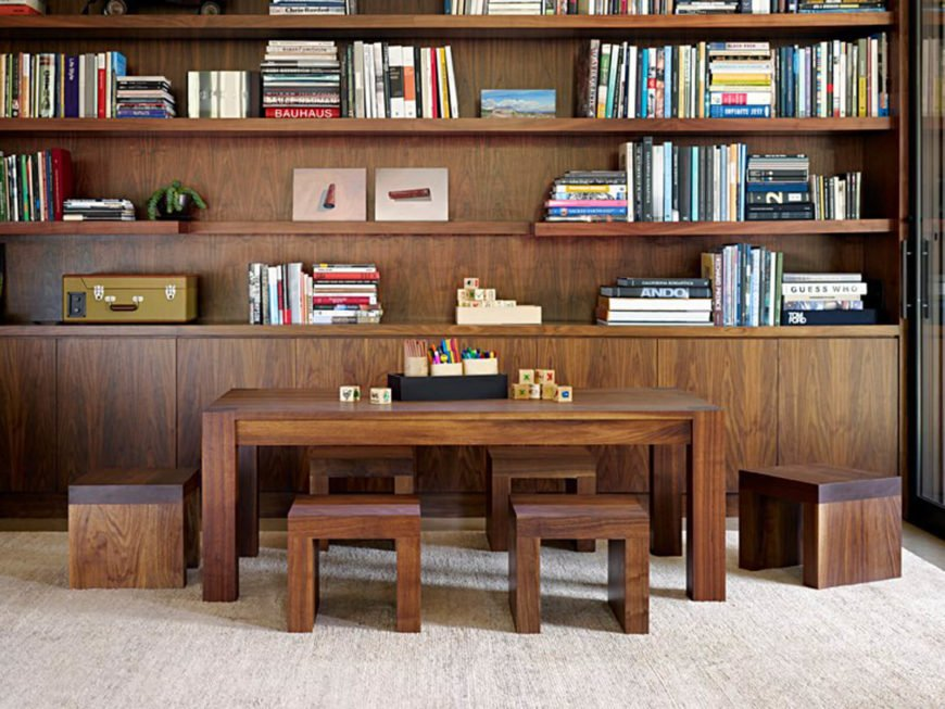 The private area contains this opulent natural wood bookshelf and matching table set with cubic seating, creating a unique library space.