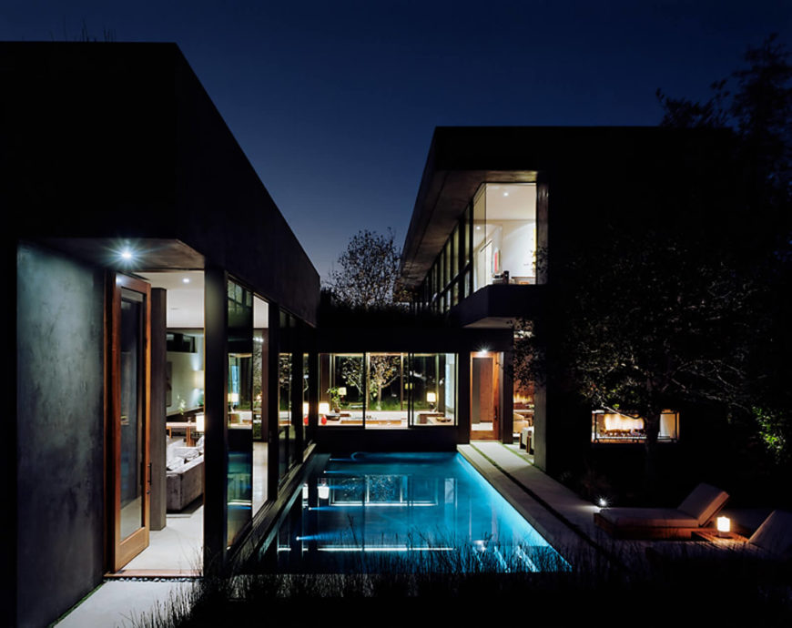 We leave you with a view of the project at night, aglow from inside, with a sprinkling a lights scattered throughout the patio and pool area.
