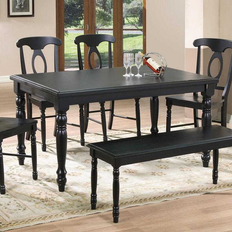 This black toned hardwood table features carved arrow foot legs and a two-tiered surface material. Adds contrast to any brightly lit or colored kitchen.
