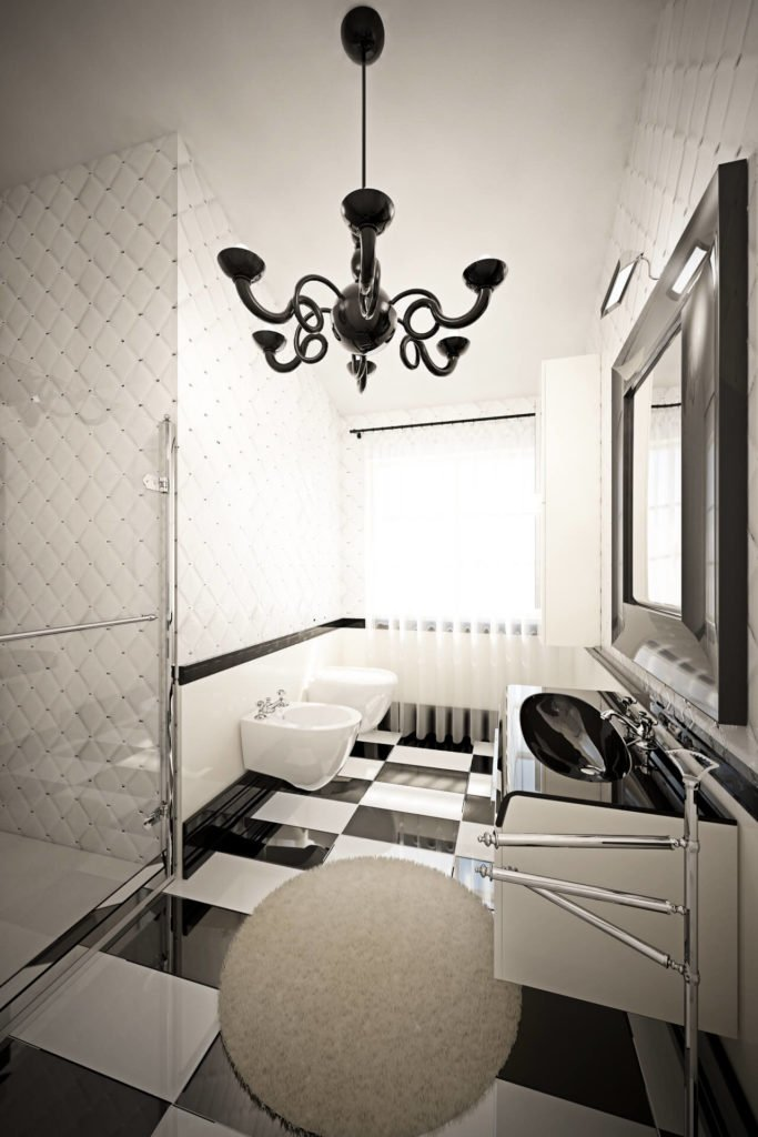 This ultra-modern bathroom features checkered floor tiles and matching, black and white floating vanity with a curved surface. Glass enclosed shower stands at left.
